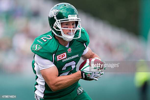 Ryan Smith of the Saskatchewan Roughriders runs after a catch in the game between the Toronto Argonauts and Saskatchewan Roughriders in week 2 of the...