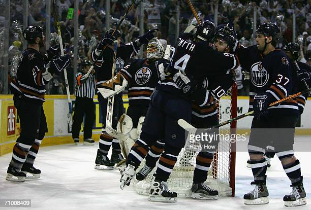 Ryan Smyth and goaltender Dwayne Roloson of the Edmonton Oilers clebrate after defeating the San Jose Sharks in game six of the Western Conference...