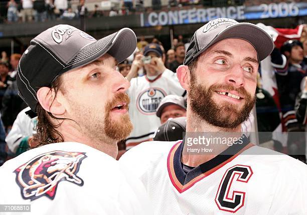 Ryan Smyth and Jason Smith of the Edmonton Oilers celebrate after the Oilers defeated the Mighty Ducks of Anaheim 21 in game five of the Western...