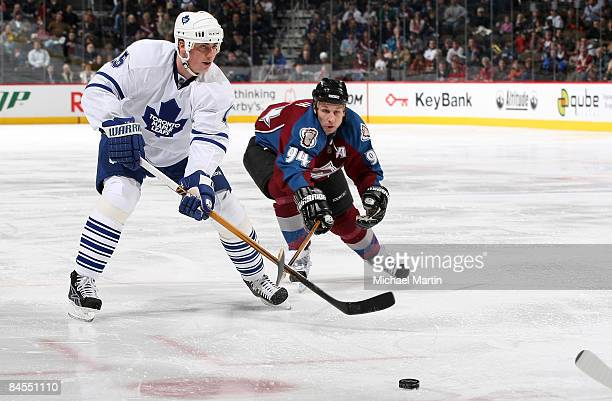 Ryan Smyth of the Colorado Avalanche skates against Tomas Kaberle of the Toronto Maple Leafs at the Pepsi Center January 29, 2009 in Denver, Colorado.