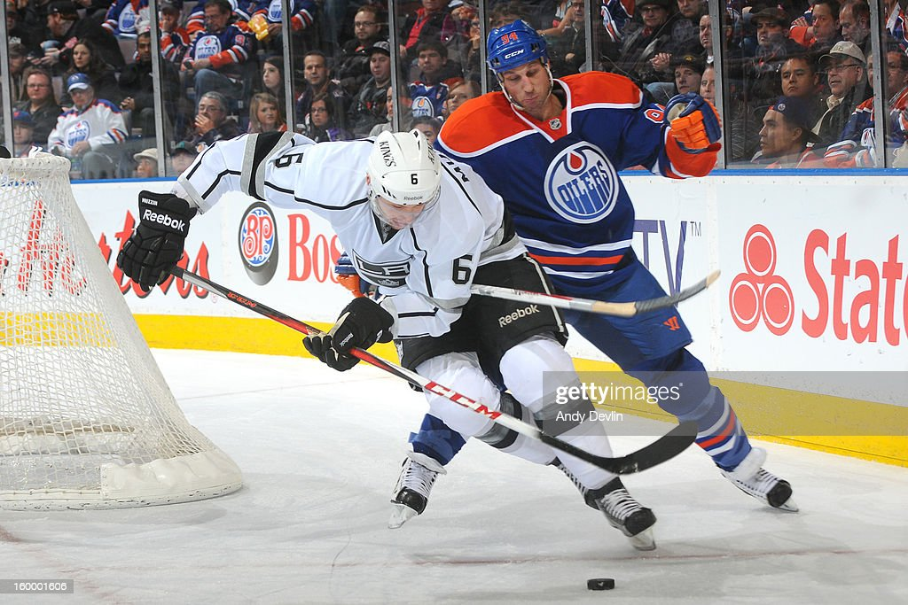 Ryan Smyth #94 of the Edmonton Oilers battles for the puck against Jake Muzzin #6 of the Los Angeles Kings at Rexall Place on January 24, 2013 in Edmonton, Alberta, Canada.
