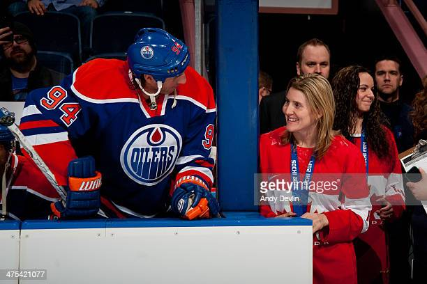 Ryan Smyth of the Edmonton Oilers exchanges words with Hayley Wickenheiser of Team Canada prior to a game against the Minnesota Wild on February 27...