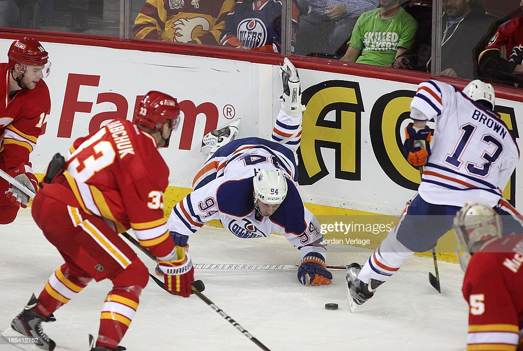 Ryan Smyth #94 of the Edmonton Oilers gets tripped up in the corner during their game against the Calgary Flames at Scotiabank Saddledome on April 3, 2013 in Calgary, Alberta, Canada.