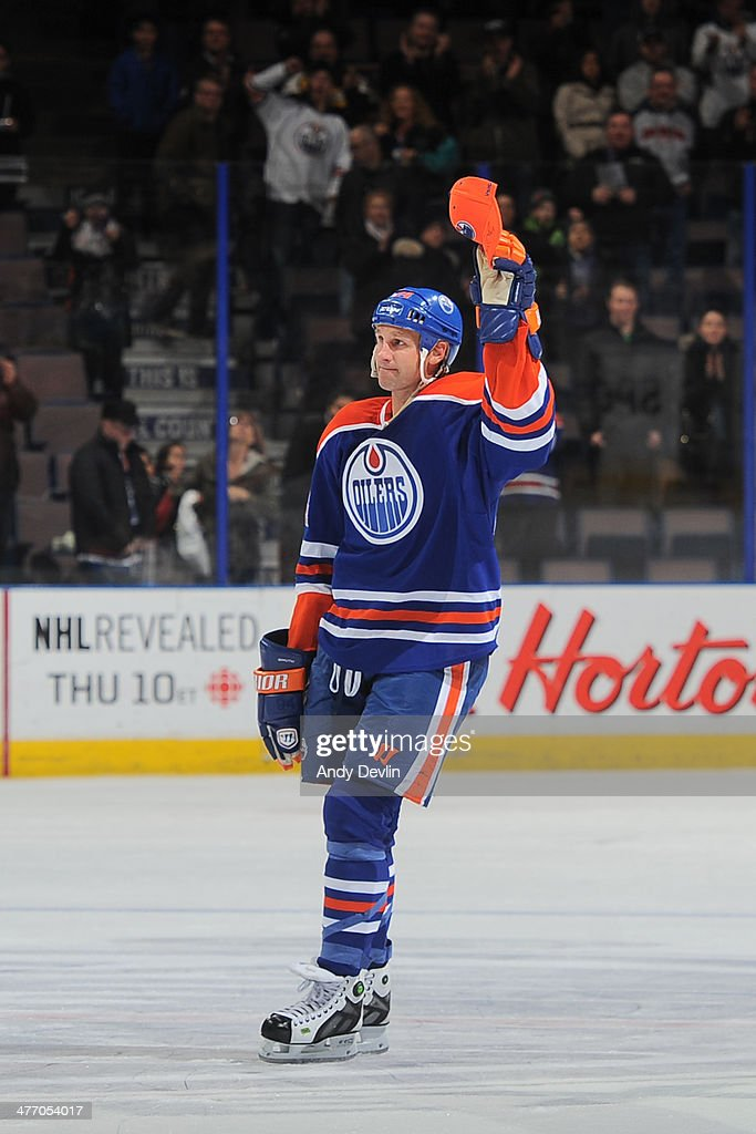 Ryan Smyth #94 of the Edmonton Oilers salutes the crowd after being selected as the first star of the game against the New York Islanders on March 6, 2014 at Rexall Place in Edmonton, Alberta, Canada.