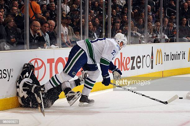 Ryan Smyth of the Los Angeles Kings gets checked into the boards by Alexander Edler of the Vancouver Canucks in Game Three of the Western Conference...