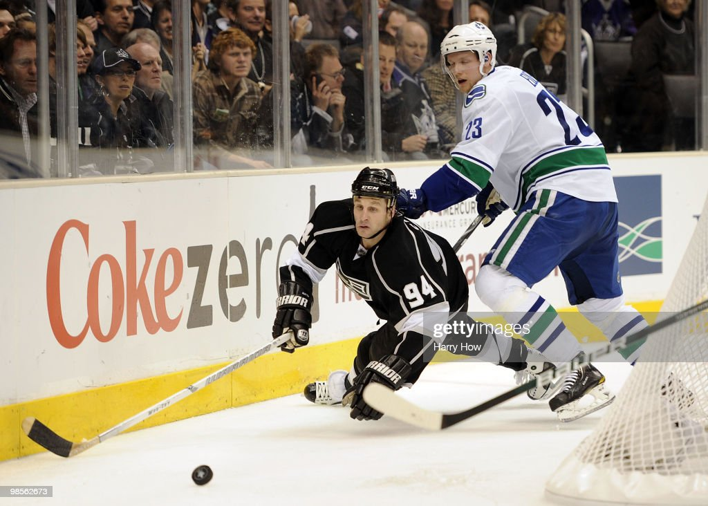 Ryan Smyth #94 of the Los Angeles Kings is knocked to the ice by Alexander Edler #23 of the Vancouver Canucks during the second period in game three of the Western Conference Semi-final at Staples Center on April 19, 2010 in Los Angeles, California.