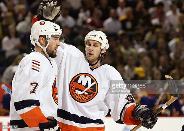 Ryan Smyth of the New York Islanders celebrates with Trent Hunter after scoring in the third period against the Buffalo Sabres during Game 5 of the...