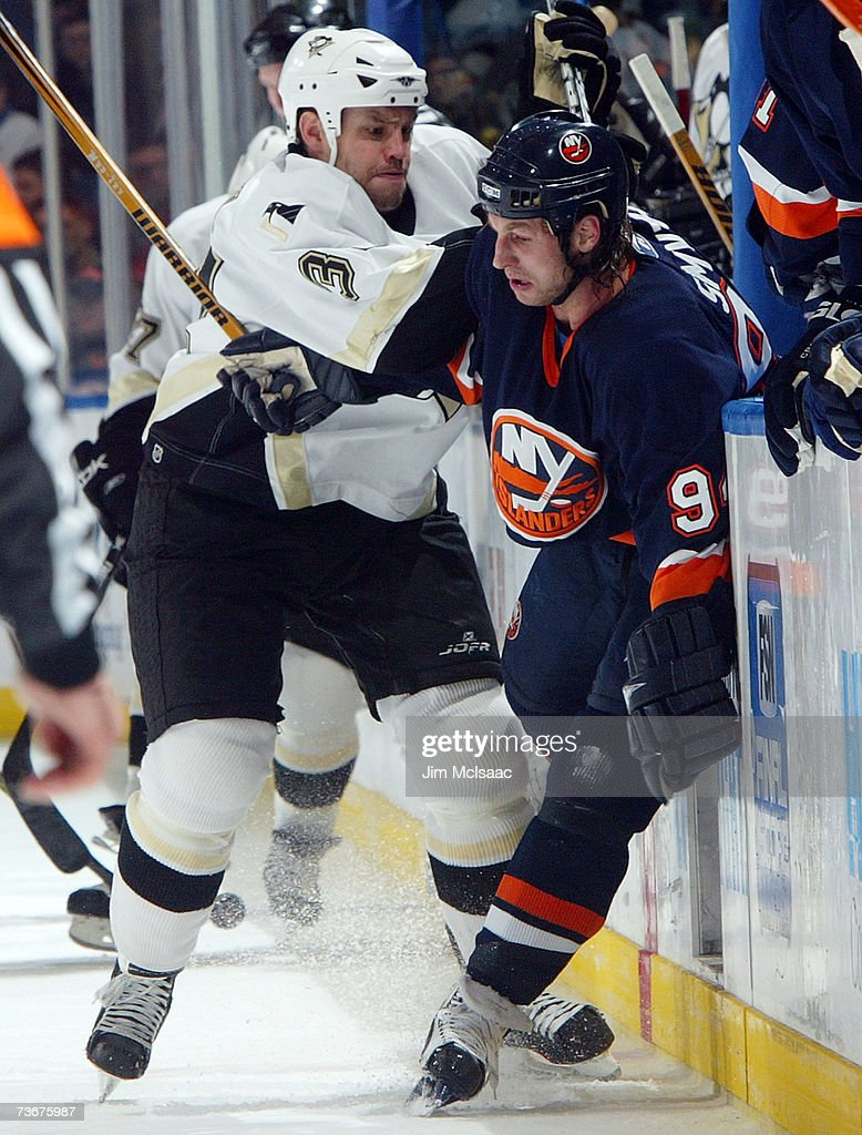 Ryan Smyth #94 of the New York Islanders takes a hit from Jarkko Ruutu #37 of the Pittsburgh Penguins during their game on March 22, 2007 at Nassau Coliseum in Uniondale, New York.