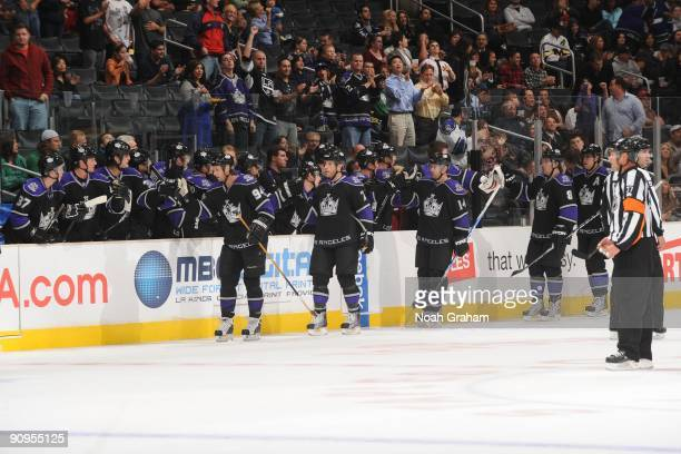 Ryan Smyth Rob Scuderi and Justin Williams of the Los Angeles Kings celebrate with the bench against the Phoenix Coyotes on September 15 2009 at...