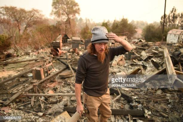 Ryan Spainhower reacts while talking about his burned home in Paradise California on November 18 2018