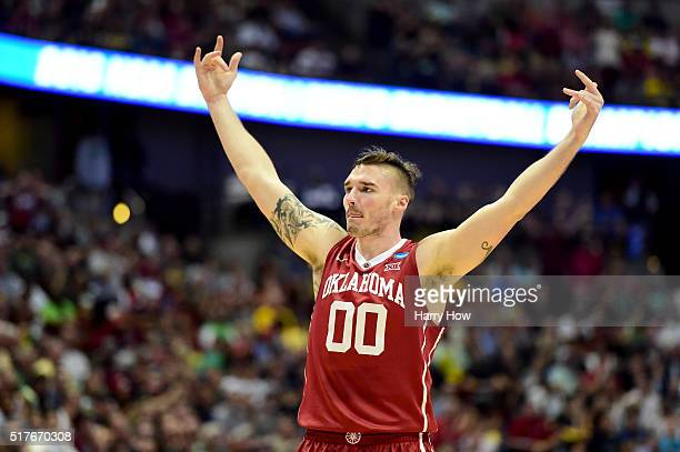 Ryan Spangler of the Oklahoma Sooners celebrates in the first half while taking on the Oregon Ducks in the NCAA Men's Basketball Tournament West...