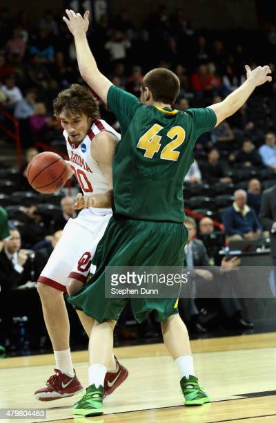 Ryan Spangler of the Oklahoma Sooners drives the ball past Marshall Bjorklund of the North Dakota State Bison during the second round of the 2014...