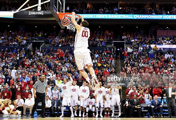 Ryan Spangler of the Oklahoma Sooners dunks against the Dayton Flyers in the second half during the third round of the 2015 NCAA Men's Basketball...