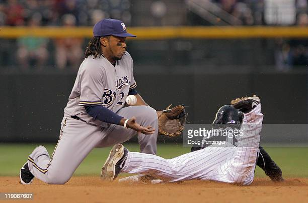 Ryan Spilborghs of the Colorado Rockies steals second base as second baseman Rickie Weeks of the Milwaukee Brewers has trouble collecting the throw...