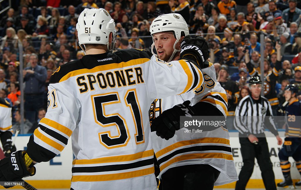 Ryan Spooner #51 and Matt Beleskey #39 of the Boston Bruins celebrate a goal against the Buffalo Sabres at First Niagara Center on January 15, 2016 in Buffalo, New York. Boston defeated Buffalo 4-1.