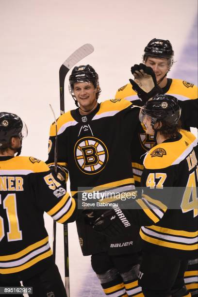 Ryan Spooner Anders Bjork Brandon Carlo and Torey Krug of the Boston Bruins celebrate a third period goal against the Columbus Blue Jackets at the TD...