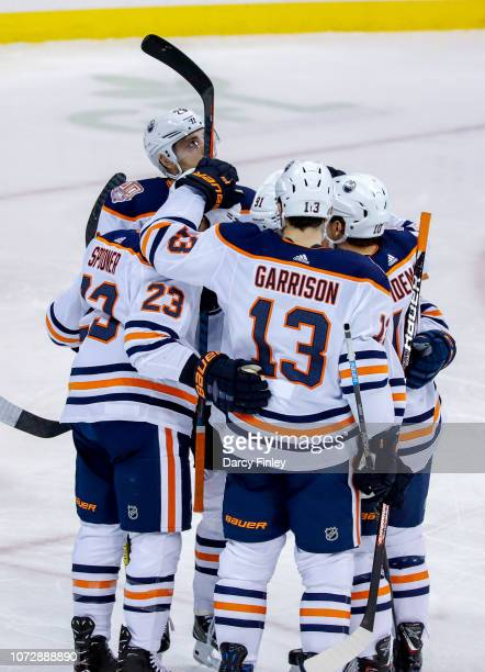 Ryan Spooner Leon Draisaitl Drake Caggiula Jason Garrison and Chris Wideman of the Edmonton Oilers celebrate a first period goal against the Winnipeg...