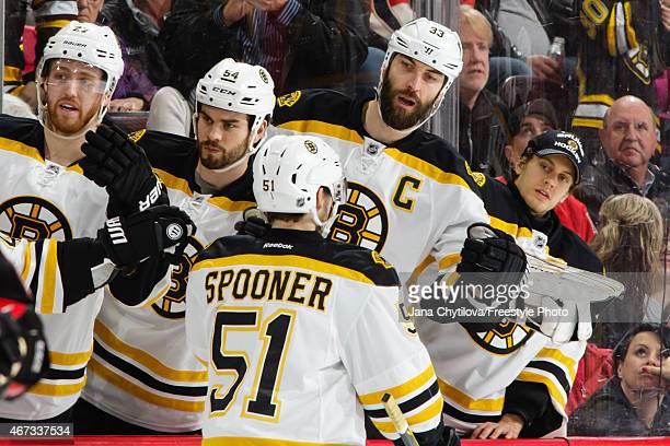 Ryan Spooner of the Boston Bruins celebrates his first period goal against the Ottawa Senators with team mates Dougie Hamilton Adam McQuaid Zdeno...