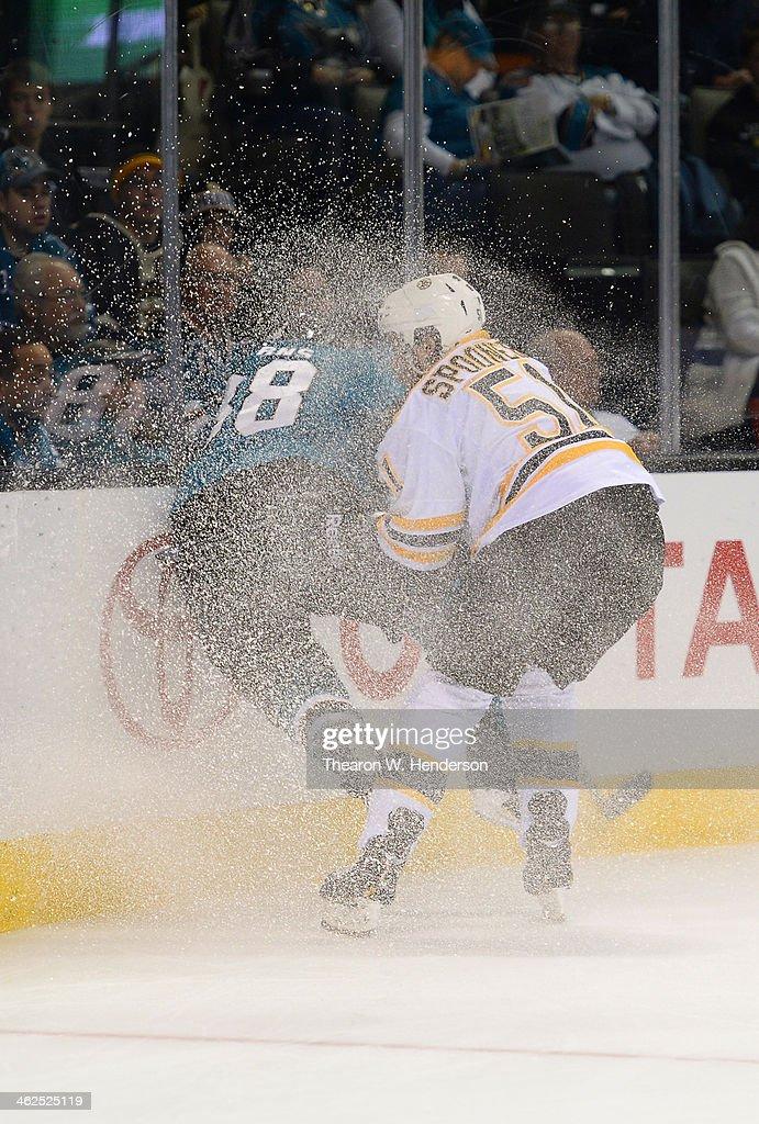 Ryan Spooner #51 of the Boston Bruins collides with Bracken Kearns #38 of the San Jose Sharks at SAP Center on January 11, 2014 in San Jose, California.