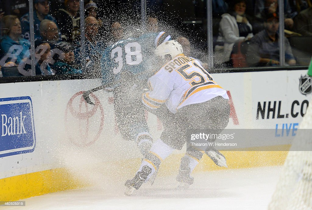 Ryan Spooner #51 of the Boston Bruins collides with Bracken Kearns #38 of the San Jose Sharks at SAP Center on January 11, 2014 in San Jose, California.