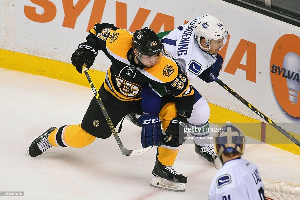 Ryan Spooner #51 of the Boston Bruins skates against Adam Clendening #44 of the Vancouver Canucks at the TD Garden on February 24, 2015 in Boston, Massachusetts.
