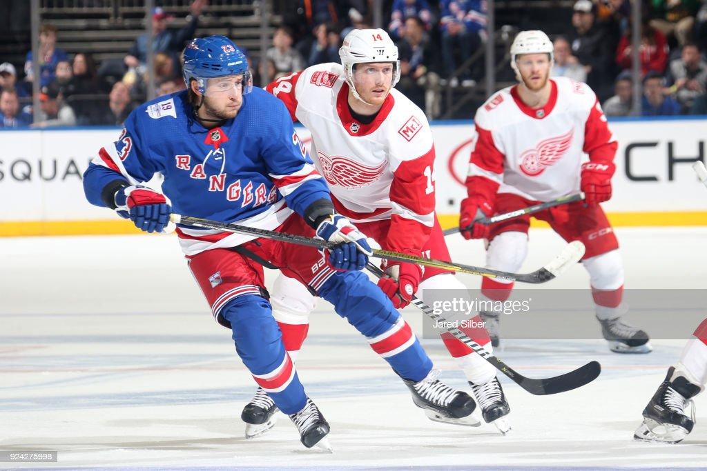 24d7ffb84e7 Ryan Spooner of the New York Rangers skates against Gustav Nyquist ...
