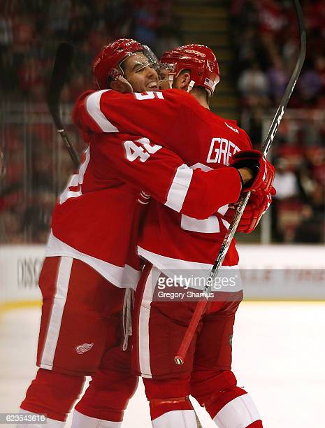 Ryan Sproul of the Detroit Red Wings celebrates his first NHL goal with Mike Green in the third period while playing the Tampa Bay Lightning at Joe...