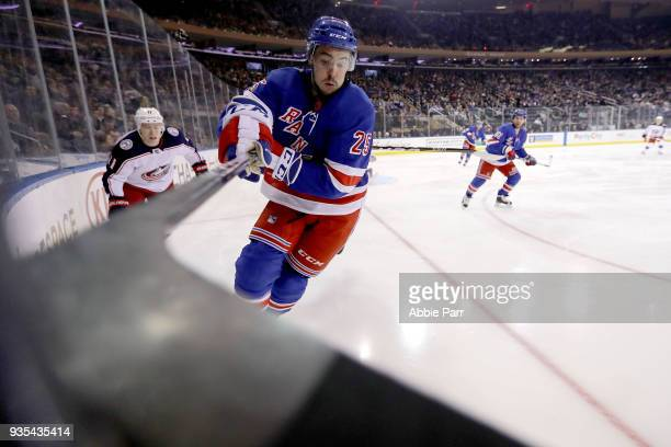 Ryan Sproul of the New York Rangers reaches for the puck in the third period against the Columbus Blue Jackets during their game at Madison Square...