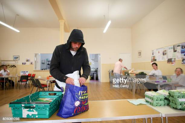 Ryan Staffiere uses a foodbank run by the charity Transformation CPR at the Camborne Centenary Methodist Church in Camborne on July 25 2017 in...