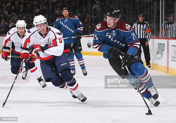 Ryan Stoa of the Colorado Avalanche skates against Kyle Wilson of the Washington Capitals at the Pepsi Center on December 15, 2009 in Denver,...