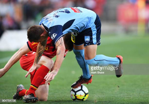 Ryan Strain of Adelaide United and Luke Wilkshire of Sydney FC during the round 16 ALeague match between Adelaide United and Sydney FC at Coopers...
