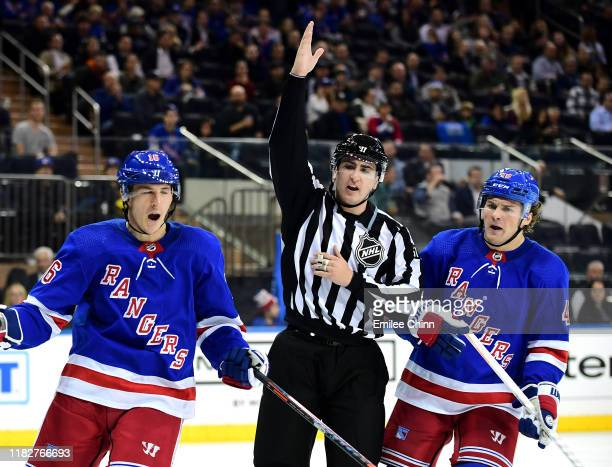 Ryan Strome and Brendan Lemieux of the New York Rangers react to a call during the second period of their game against the Arizona Coyotes at Madison...