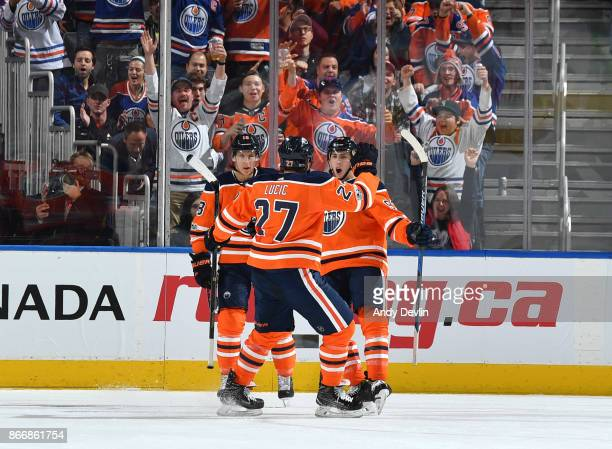 Ryan Strome Milan Lucic and Ryan NugentHopkins of the Edmonton Oilers celebrate after a goal during the game against the Dallas Stars on October 26...