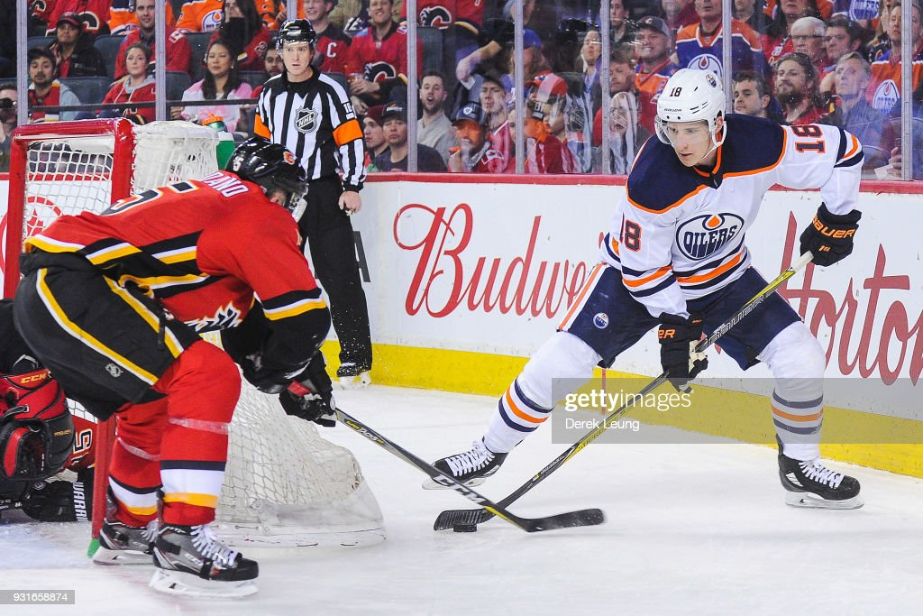 Ryan Strome #18 of the Edmonton Oilers carries the puck against Mark Giordano #5 of the Calgary Flames during an NHL game at Scotiabank Saddledome on March 13, 2018 in Calgary, Alberta, Canada.