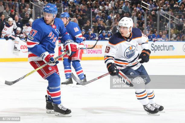 Ryan Strome of the Edmonton Oilers skates against Steven Kampfer of the New York Rangers at Madison Square Garden on November 11 2017 in New York City