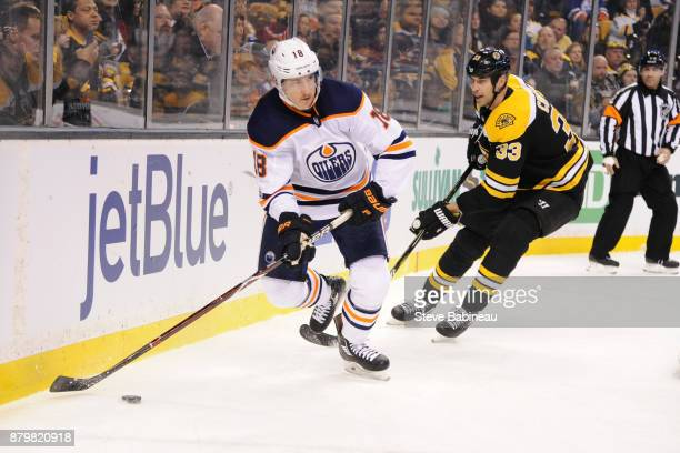 Ryan Strome of the Edmonton Oilers skates with the puck against Zdeno Chara of the Boston Bruins at the TD Garden on November 26 2017 in Boston...