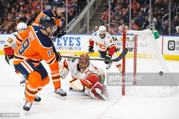 Ryan Strome of the Edmonton Oilers takes a shot on goaltender David Rittich of the Calgary Flames at Rogers Place on January 25 2018 in Edmonton...