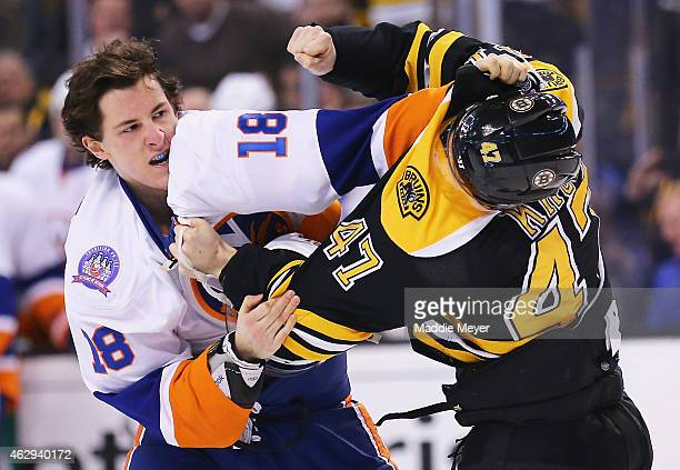 Ryan Strome of the New York Islanders and Torey Krug of the Boston Bruins exchange punches during the first period at TD Garden on February 7 2015 in...