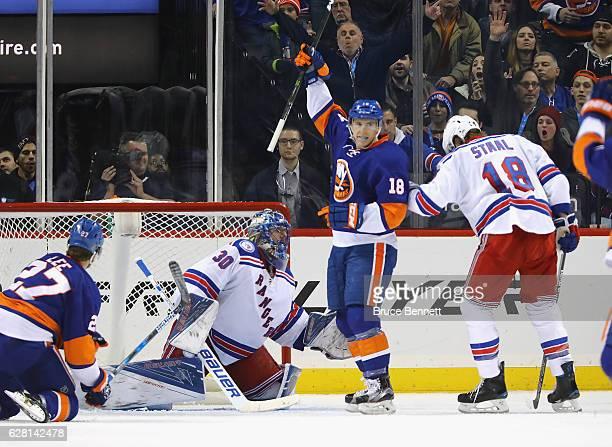 Ryan Strome of the New York Islanders celebrates a powerplay goal by John Tavares against Henrik Lundqvist of the New York Rangers at 11:13 of the...