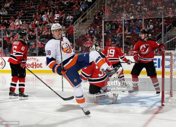 Ryan Strome of the New York Islanders celebrates his third period goal against the New Jersey Devils at the Prudential Center on April 11, 2014 in...