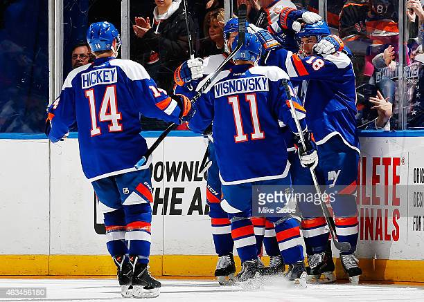 Ryan Strome of the New York Islanders is congratulated by his teammates after scoring a second period goal against the Columbus Blue Jackets at...