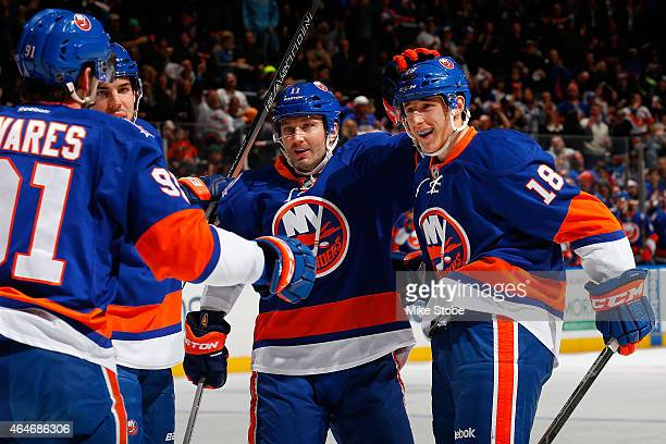 Ryan Strome of the New York Islanders is congratulated by teammates after scoring a first period goal against the Calgary Flames in his 100th career...
