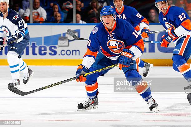 Ryan Strome of the New York Islanders skates against the Winnipeg Jets at Nassau Veterans Memorial Coliseum on October 28, 2014 in Uniondale, New...