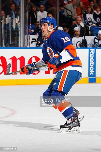 Ryan Strome of the New York Islanders skates against the Winnipeg Jets at Nassau Veterans Memorial Coliseum on October 28, 2014 in Uniondale, New...
