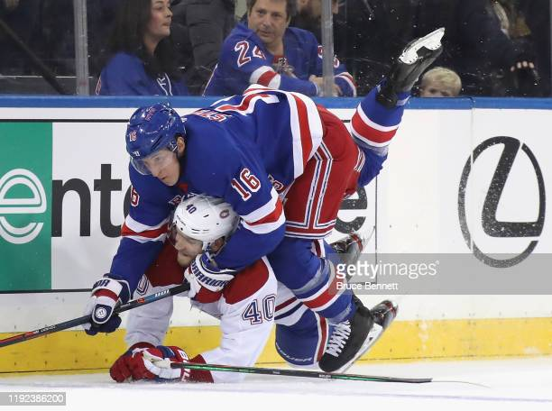Ryan Strome of the New York Rangers and Joel Armia of the Montreal Canadiens combine along the far boards during the second period at Madison Square...