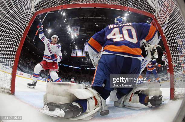 Ryan Strome of the New York Rangers celebrates a second period goal by Colin Blackwell against Semyon Varlamov of the New York Islanders at Nassau...