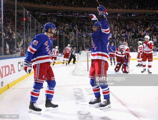 Ryan Strome of the New York Rangers celebrates his powerplay goal at 849 of the second period against the Detroit Red Wings and is joined by Artemi...