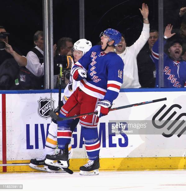 Ryan Strome of the New York Rangers celebrates his third period goal against Carter Hutton of the Buffalo Sabres at Madison Square Garden on October...