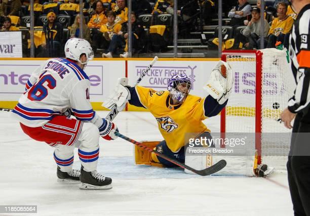 Ryan Strome of the New York Rangers scores a goal against goalie Juuse Saros of the Nashville Predators during the second period at Bridgestone Arena...