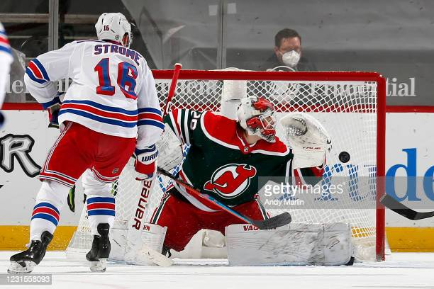 Ryan Strome of the New York Rangers scores a goal past Mackenzie Blackwood of the New Jersey Devils during the first period at Prudential Center on...
